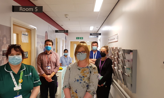 CAPTION: L-R Jo-Ann Nicholson (Senior Clinical Nurse Practitioner), Dr Ben Parker (Consultant Rheumatologist), Preetha Mathew (Research Nurse), Helen Nicholds (patient), Professor Ian Bruce (Chief Investigator, NIHR IMID BioResource), Kate Stirling (IMID Manchester Project Assistant)